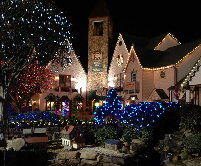 in downtown with mountains celebrate christmas trolley cabin holiday the a or smoky rentals gatlinburg lights cabins